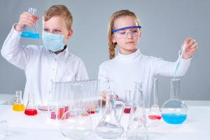 two kids with chemistry set